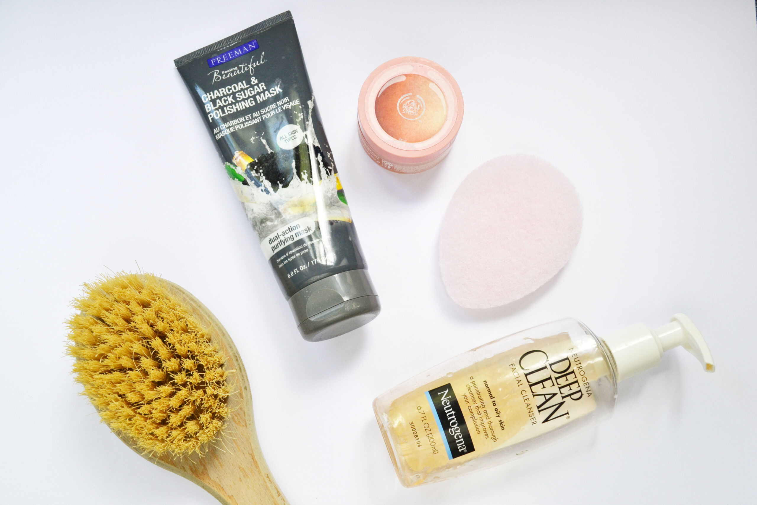 exfoliating brush, freemans mask, exfoliating face mask, freemans, the body shop exfoliation cream, neutrogena, neutrogena cleanser, beauty, flatlay,