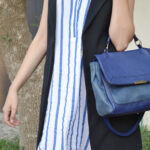 outfit details, ankle boots, blue bag, long waistcoat,
