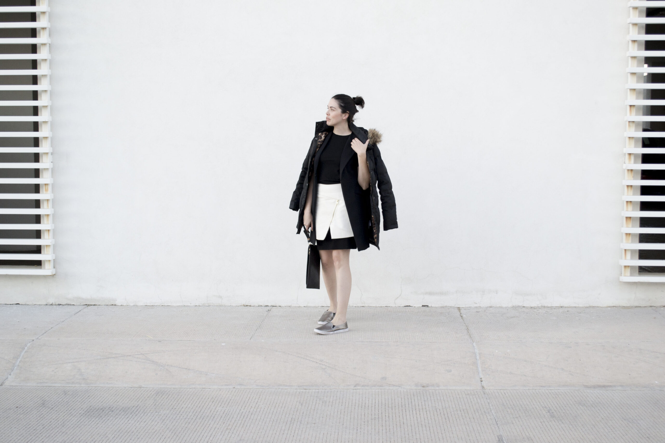 daniela soriano, puffer jacket, long, layering, black dress, leather skirt, white, vegan leather, metallic, slip on sneakers, outfit ideas
